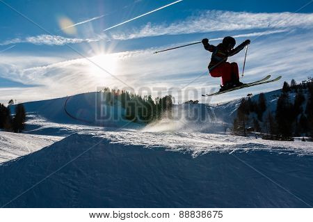 Little Skier Performs Jump In The Snow, silhouette