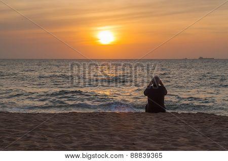 Older Man Watching At The Ocean Sunset