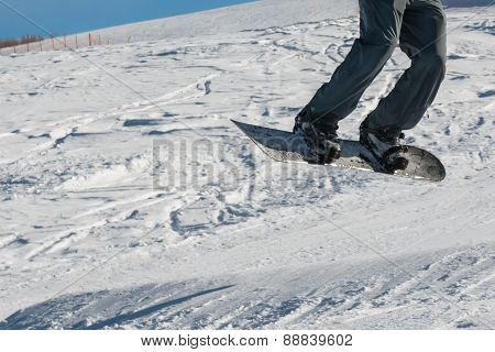 Closeup Of Freestyle Snowboarder Jump