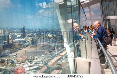 LONDON, UK - APRIL 22, 2015: People looking at the London's skyline. Viewing platform of Walkie-Tal
