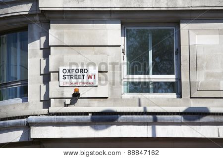 LONDON, UK - APRIL 22: Detail of Oxford Street sign next to an empty window. April 22, 2015 in London. Oxford Street is the main commercial street in the city.