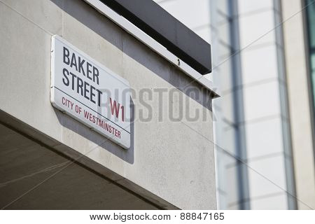 LONDON, UK - APRIL 22: Detail of Baker Street sign on empty white building wall. Lots of copy space. April 22, 2015 in London. The street was brought to fame by Sherlock Holmes's adventures.
