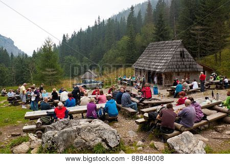 Tourists Take A Rest And Have Snacks On Strazyska Meadow