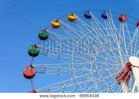 Giant Ferris Wheel Against Blue Sky