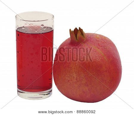 glass of juice of pomegranate and red garnet