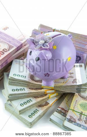 Saving concepth, piggy bank on money isolated on white background.