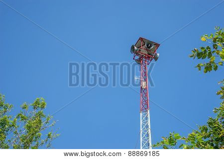 Speaker On High Tower And Clear Sky With Tree As A Foreground