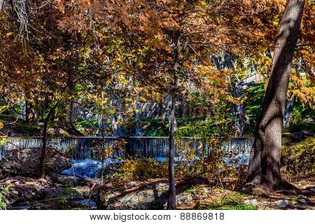 A Beautiful Waterfall Hidden in the Fall Foliage on the Guadalupe River, Texas.