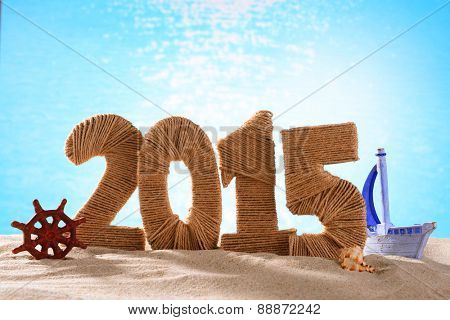 2015 sign on beach sand