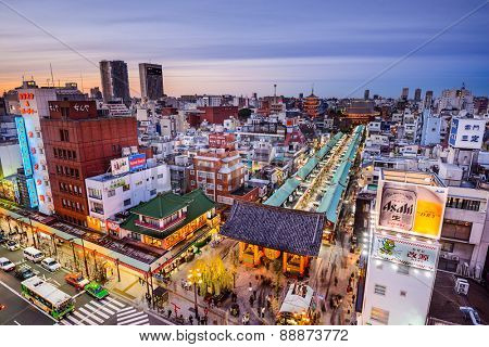TOKYO, JAPAN - JANUARY 6, 2013: Skyline over the arcade of Sensoji Temple and the Asakusa District during twilight.