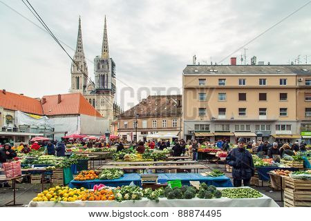 ZAGREB, CROATIA - 12 MARCH 2015: Dolac market full of fruits and vegetables with a view of Zagreb Cathedral.