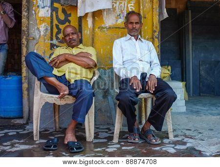 MUMBAI, INDIA - 10 JANUARY 2015: Indian vendors sitting infront of shops.
