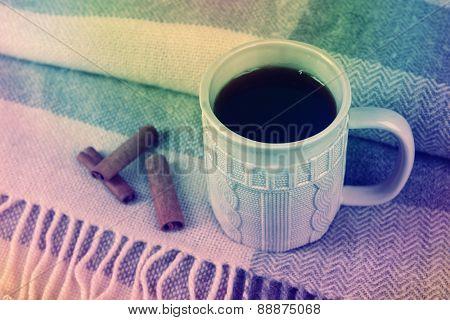 Cup of tea on plaid, vintage effect