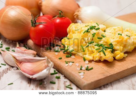 Breakfast With Scrambled Eggs And Tomatoes