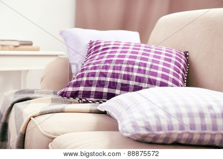 Interior design with pillows on sofa, closeup