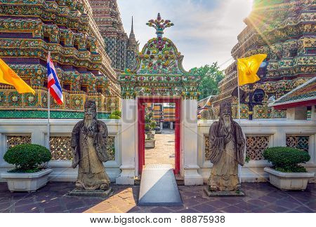 Wat Pho, an ancient remains important of Thailand with sunbeams