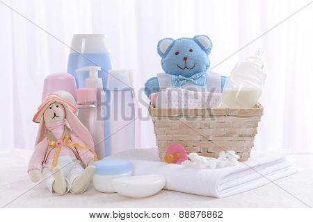 Baby accessories on table on light background