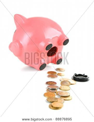 Opened piggy bank with coins, isolated on white