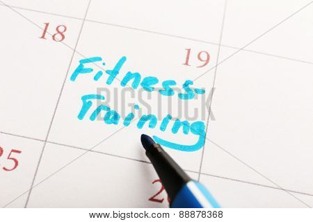 Written plan Fitness Training  on calendar page background