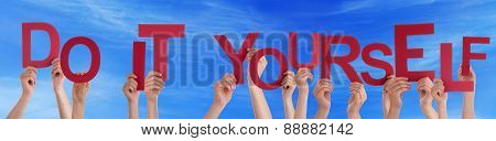 People Hands Holding Red Word Do It Yourself Blue Sky