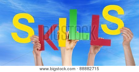 Many People Hands Holding Colorful Word Skills Blue Sky
