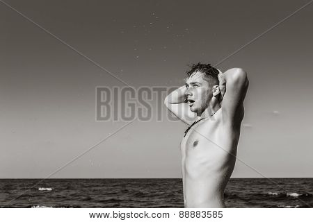 Attractive Young Man In The Sea Getting Out Of Water With Wet Hair In Black And White