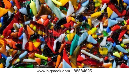 Pattern of colorful melted plastic pieces