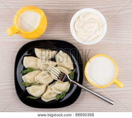 Dumplings On Plate, Mayonnaise, Jug And Cup Of Milk