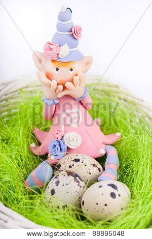 Ashamed fairy on the nest with quail eggs