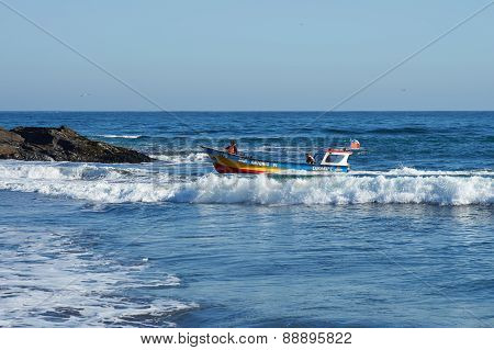 Fishing Boat Returns with the Catch