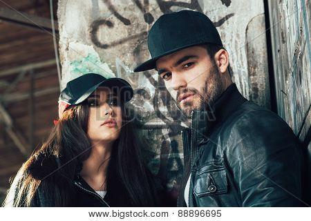 Young Urban Couple Posing Selective Focus On Man