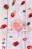 picture of strawberry  - delicious healthy strawberry smoothie with fresh strawberries on wooden background - JPG