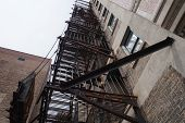 pic of illinois  - Looking up at a fire escape on a large building in Joliet - JPG