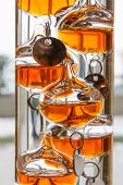 stock photo of galileo-thermometer  - the Galilean thermometer atmospheric temperature measurement device - JPG