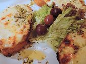 image of antipasto  - parmesan bruschetta antipasto on a white plate with olives - JPG