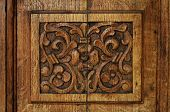 image of sag  - traditional door panel carved in wood at the old monastery - JPG