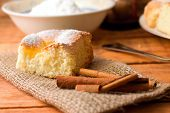 picture of curd  - Horizontal photo of single portion of curd fresh cake on jute cloth together with few pieces of cinnamon - JPG