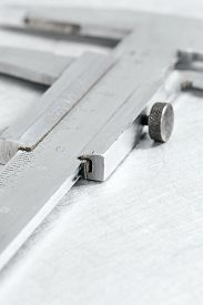 picture of vernier-caliper  - Stainless steel vernier caliper on scratched metal background - JPG
