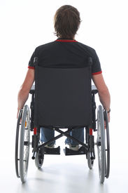 image of rollator  - photo of a young man sitting on a wheelchair - JPG