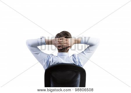 Rear View Of The Relaxing Businessman In The Office Chair. Isolated.