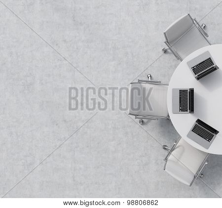 Top View Of A Half Of The Conference Room. A White Round Table, Three White Leather Chairs. Three La