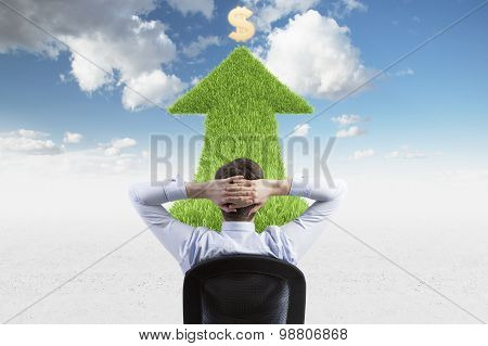 Rear View Of The Relaxing Businessman Who Thinks About Further Steps In Business Development. Green