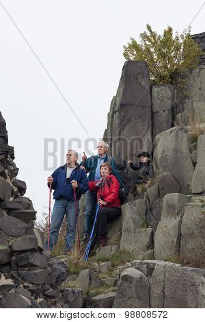 Seniors And Child Hiking On The Rock