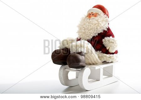 Father Christmas Sitting On Sledge  Isolated On White Background