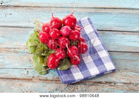 Close Up Of Red Radish Bundle On Checked Napkin