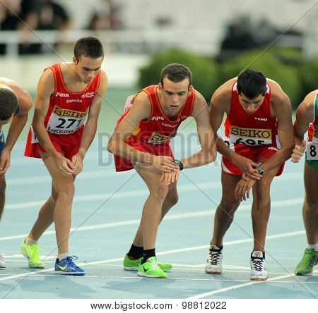 BARCELONA - JULY, 10: Group of Athletes during 10000m event of the 20th World Junior Athletics Championships at the Olympic Stadium on July 10, 2012 in Barcelona, Spain