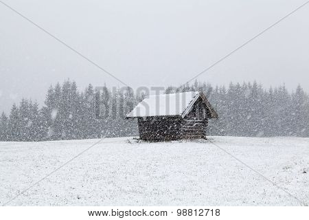 Heavy Snowstorm Over Old Wooden Hut