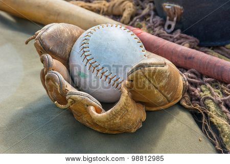 Worn Leather Basball Mitt With Bat.