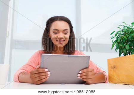 Young mulatto girl using tablet