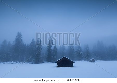 Misty Winter Morning On Alpine Countryside
